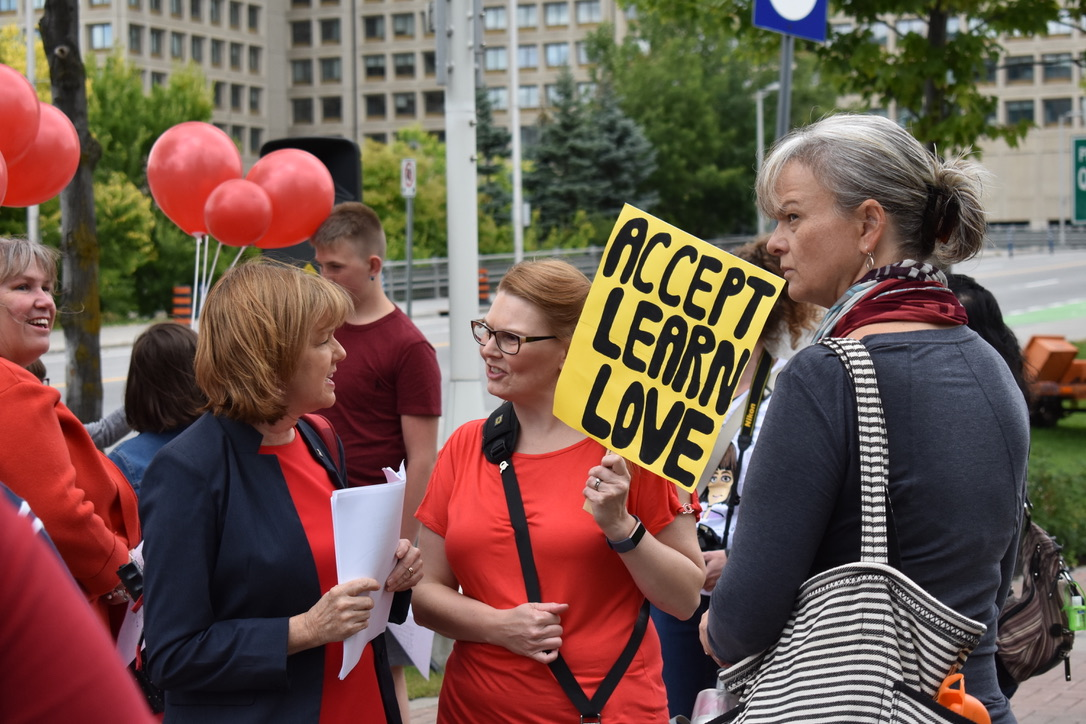 FASD Walk Participants with Accept, Learn Love Placard